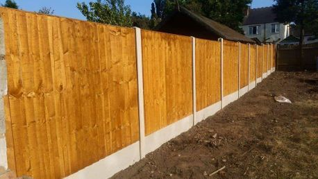 wood and lap panel fencing