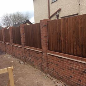 modern brick and wood fencing